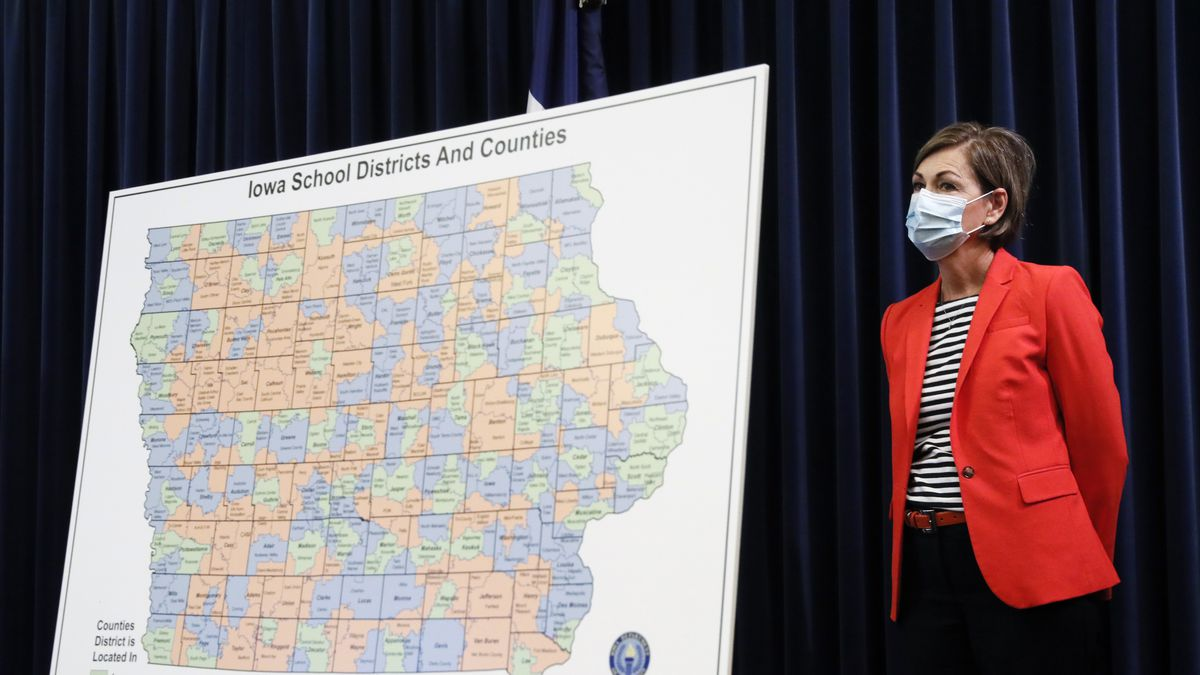Iowa Gov. Kim Reynolds listens to a question during a news conference on the state's guidance for returning to school in response to the coronavirus outbreak, Thursday, July 30, 2020, in Des Moines, Iowa. (AP Photo/Charlie Neibergall)