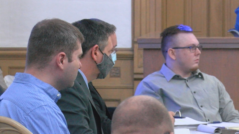 Michael Bibby (left) and Dalton Cook (right) with their attorneys.