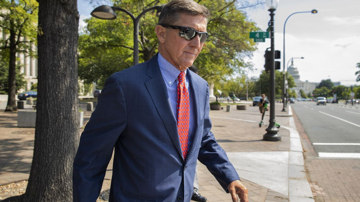 FILE - In this Sept. 10, 2019 file photo, Michael Flynn, President Donald Trump's former national security adviser, leaves the federal court following a status conference in Washington.