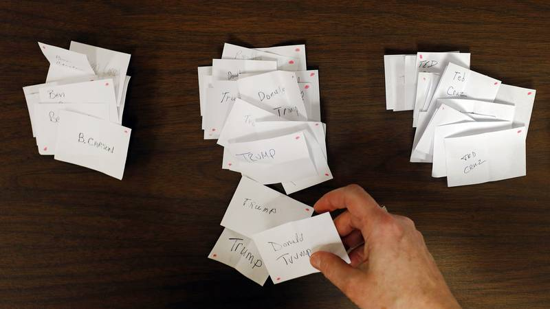 Precinct secretary Michelle Anderson counts votes for Republican candidates during a caucus in...