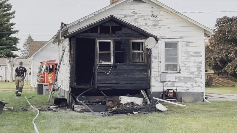 Crews responded to a Boone Street household after the back porch caught fire Friday afternoon.