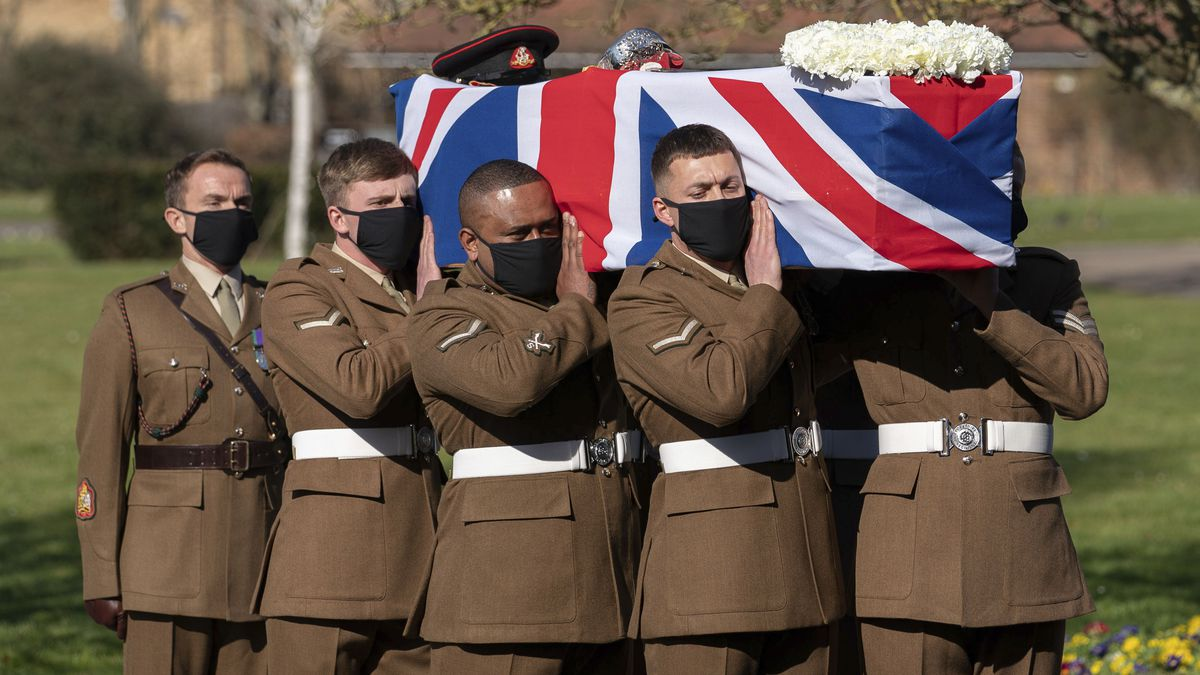 The coffin of Captain Sir Tom Moore is carried by members of the Armed Forces during his...
