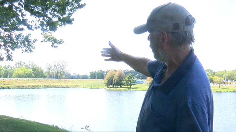 Marvin Hertz shows where he discovered body in lagoon.