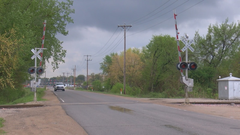 A woman is fed up with trains sitting in the intersection to her business. So, she started a...