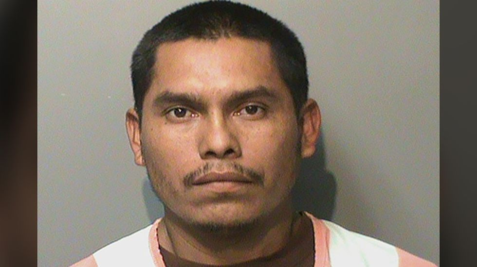 FILE - In this booking photo released by the Polk County, Iowa, Jail, is Marvin Oswaldo...