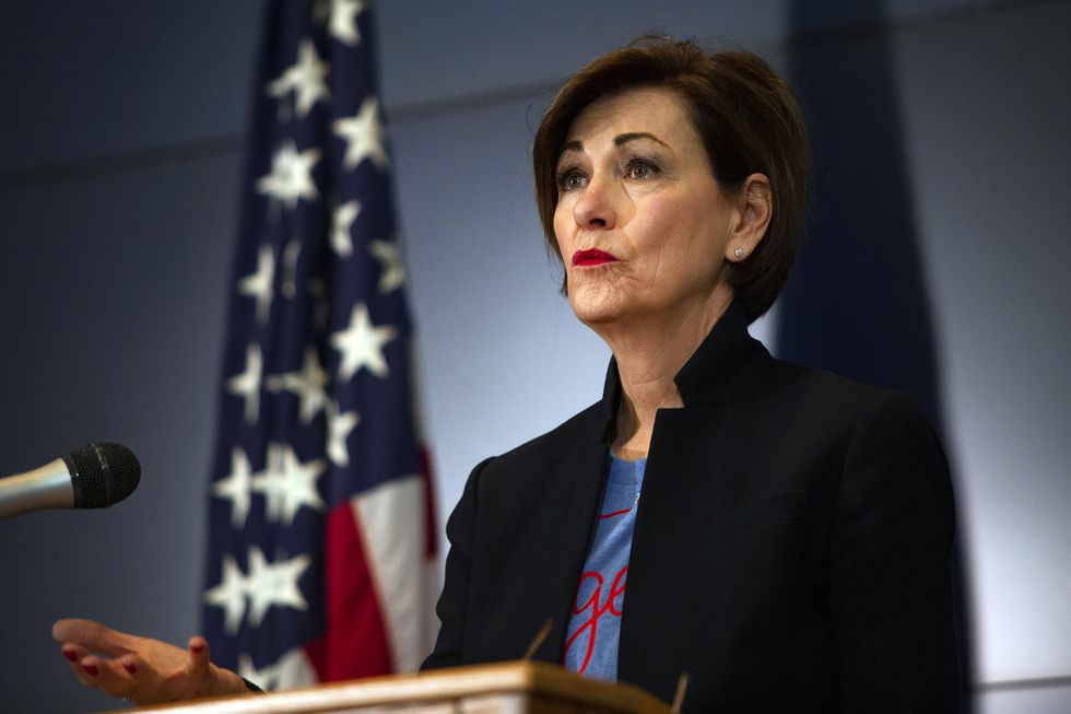"""Iowa Gov. Kim Reynolds announces updates on COVID-19 in the state, Friday, April 24, 2020, in Johnston, Iowa. Gov. Reynolds permitted statewide health systems to resume elective procedures as well as farmers markets under distancing parameters starting April 27. Reynolds stated the end of April as when the current """"bulk of declarations"""" on business closings will expire. (Olivia Sun/The Des Moines Register via AP, Pool)"""