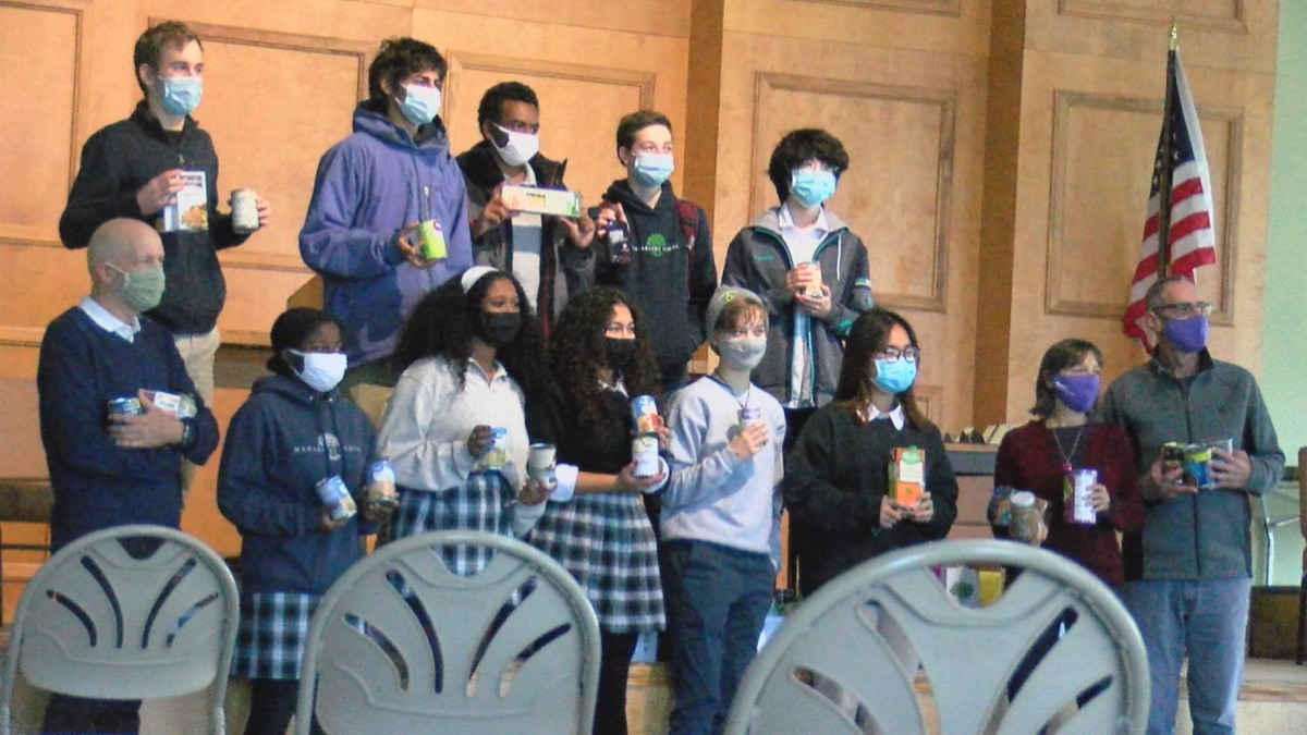 Maharishi students donate food to Fairfield's Little Free Pantries as part of their Act of...
