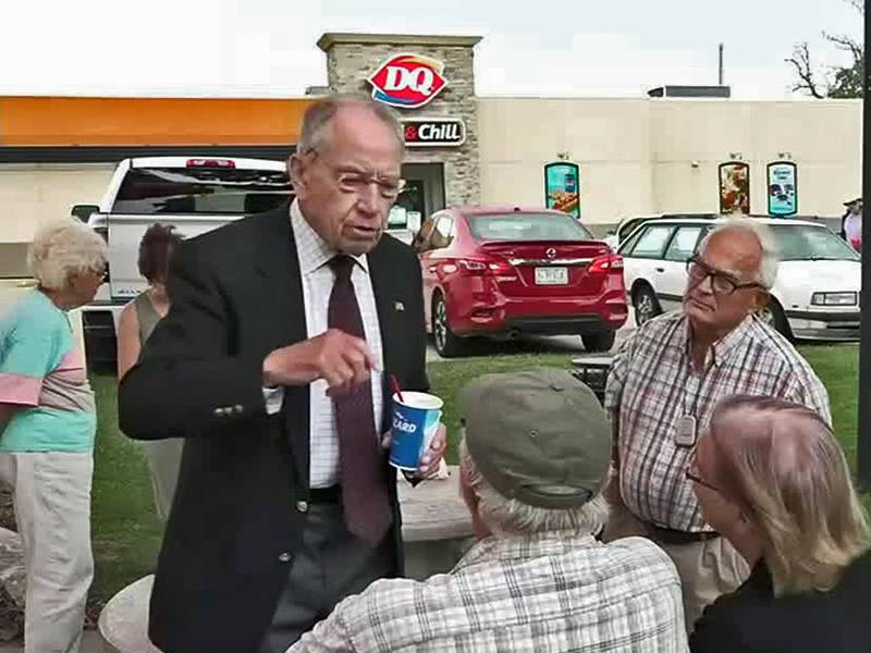 Sen. Chuck Grassley (R-IA) speaks to potential voters outside a Dairy Queen in Dyersville on...