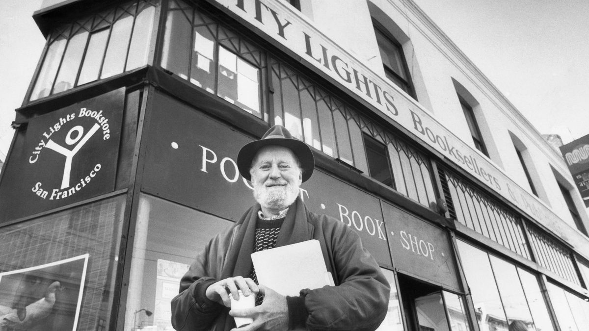 Poet Lawrence Ferlinghetti poses on Monday, Jan. 15, 1988 in San Francisco in front of the...