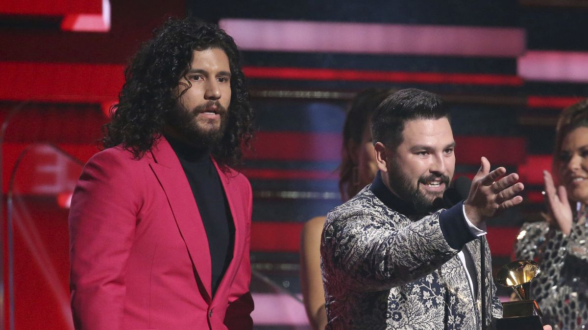 Dan Smyers, left, and Shay Mooney, of Dan + Shay, accept the award for best country duo/group...