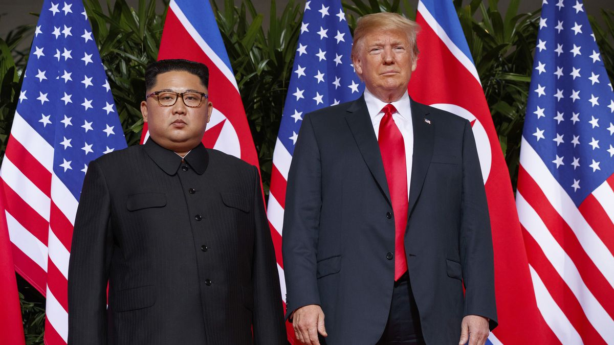 """In this June 12, 2018, file photo, U.S. President Donald Trump, right, meets with North Korean leader Kim Jong Un on Sentosa Island, in Singapore. North Korea on Saturday, July 4, 2020, reiterated it has no immediate plans to resume nuclear negotiations with the United States unless Washington discards what it describes as """"hostile"""" polices toward Pyongyang."""