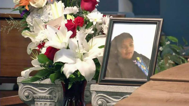 A photo of Michael Jaramillo sits next to flowers at a memorial service held in Des Moines on...