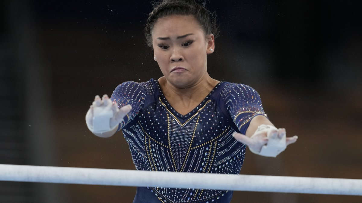 Sunisa Lee of the United States performs on the uneven bars during the artistic gymnastics...