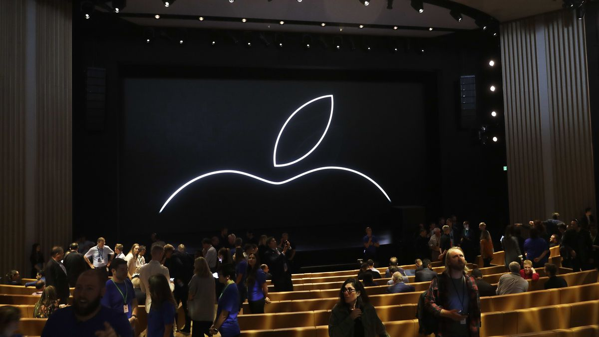 People file into the Steve Jobs Theater before an event to announce new Apple products...