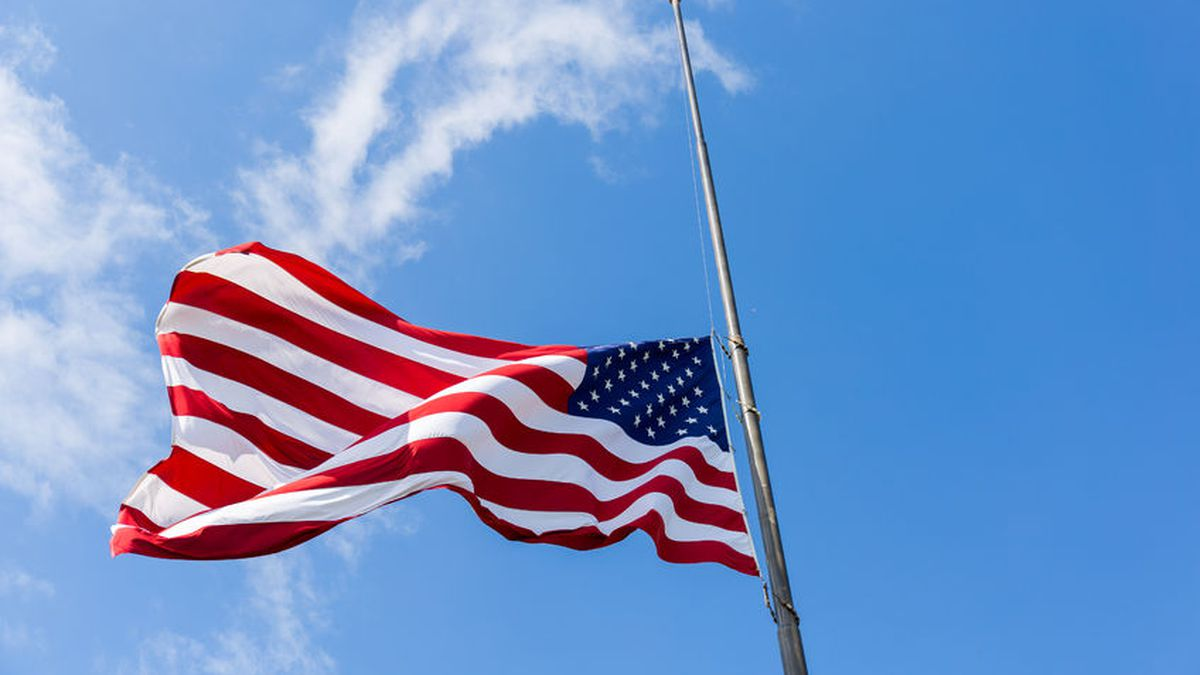 94393560 - united states flag flying at a half-staff